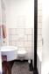 Bad mit Wanne und Duschvorhang